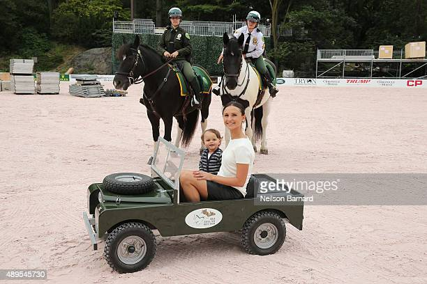 Equestrian Rider Georgina Bloomberg and son Jasper Bloomberg ride in a mini electric Land Rover Series vehicle at the Rolex Cental Park Horse Show...