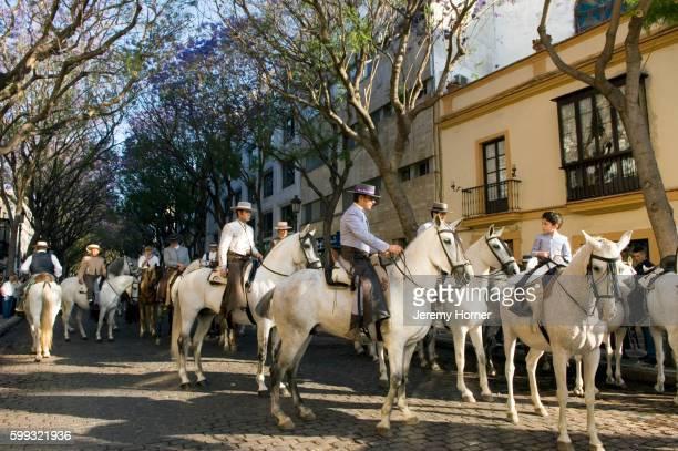 equestrians gathering on street - jerez de la frontera fotografías e imágenes de stock
