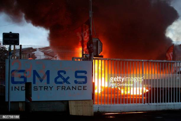 Equipment and barricade are on fire during a demonstration of employees of the GMS ailing car parts factory in La Souterraine north of the city of...