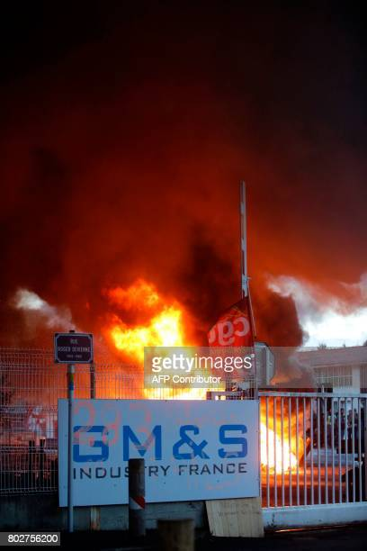 Equipment and barricade are on fire during a demonstration of employees of the GM&S ailing car parts factory in La Souterraine, north of the city of...