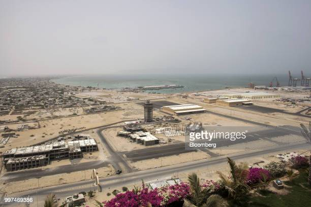 Equipment and materials sit at a developemt site near Gwadar Port operated by China Overseas Ports Holding Co in Gwadar Balochistan Pakistan on...