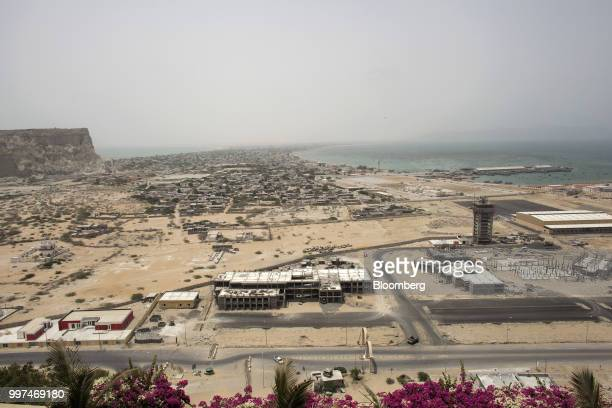 Equipment and materials sit at a development site near Gwadar Port operated by China Overseas Ports Holding Co in Gwadar Balochistan Pakistan on...