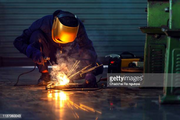 equipment industry worker welder working welding mask safety - male erection stock pictures, royalty-free photos & images