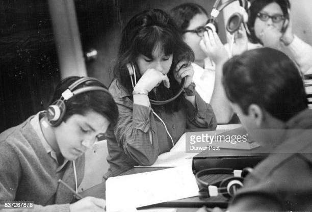 Equipment special attention speed students' reading Students using AudX machines from left are Eddy Sena Sherry Archibeque Betty Zepeda Rene Padilla...