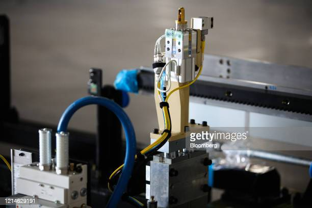Equipment waits to be installed in the body shop area of the Lucid Motors Inc. Manufacturing facility while under construction in Casa Grande,...