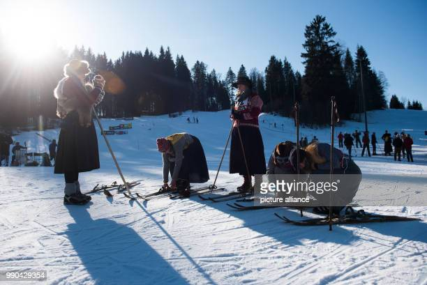 Equipped with wooden skis and wearing traditional clothes, skiers prepare for a nostalgic ski race in Kruen, Germany, 13 January 2018. Photo:...
