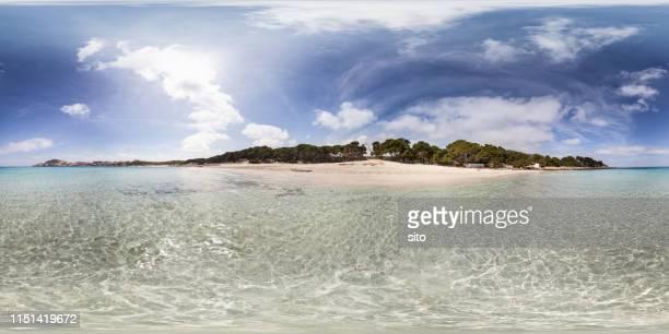 equirectangular panorama taken from the water on a sunny day at cala agulla, mallorca, spain - vista de 360 graus imagens e fotografias de stock