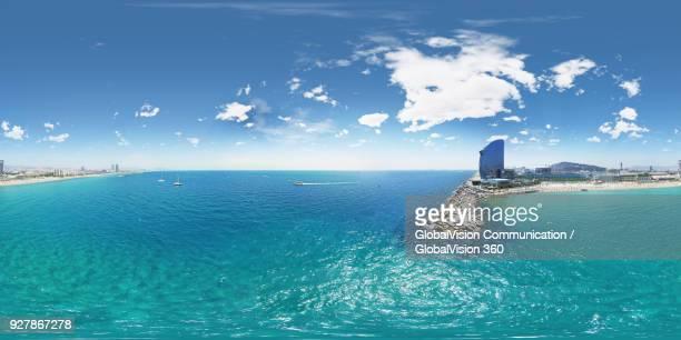 360° equirectangular photo up above la barceloneta and sant sebastia beach in barcelona, spain - 360 fotografías e imágenes de stock