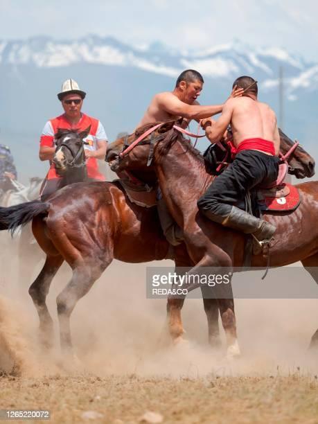 Er Enish or Oodarysh. Wrestling from horseback. A traditional equestrian sport. Folk and Sport festival on the Suusamyr plain commemorating Mr...