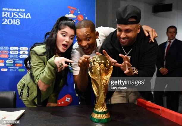 Era Istrefi Will Smith and Nicky Jam pose with the World Cup trophy at a closing ceremony press conference during the 2018 FIFA World Cup at Luzhniki...
