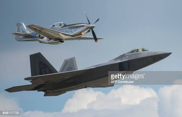 A WWII era P51 Mustang and an F22 Raptor do a flyby during the airshow at Joint Andrews Air Base in Maryland on September 16 2017 / AFP PHOTO /...