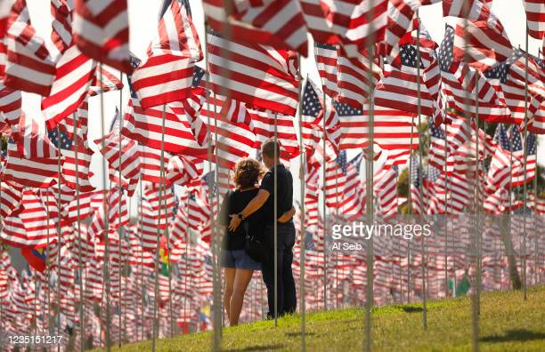 Eran and Ruth Kahn on vacation from Israel for the first time visit the annual Waves of Flags display and remembrance at Pepperdine University in...