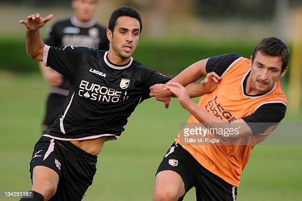 Eran Zahavi and Armin Bacinovic of Palermo in action during a Palermo training session at Tenente Carmelo Onorato Sports Center on November 29 2011...