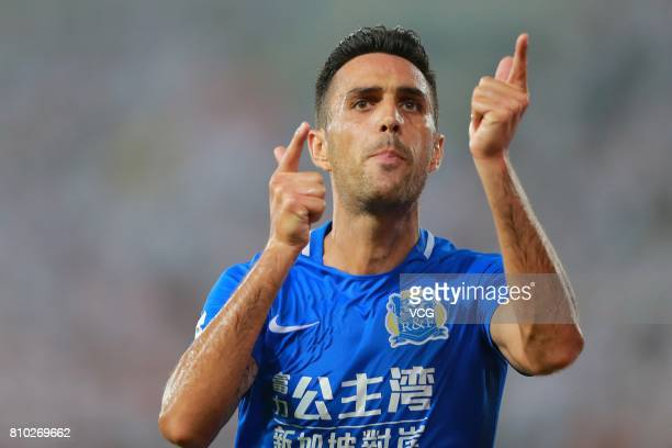 Eran Zahavi of Guangzhou RF celebrates after scoring his team's first goal during the 16th round match of 2017 Chinese Football Association Super...