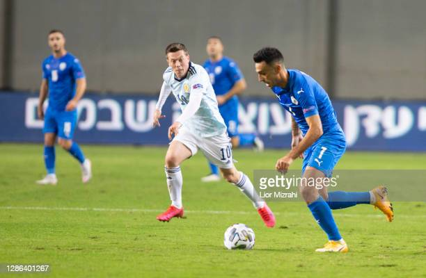 Eran Zahavi of Israel challenged by Callum Mcgregor of Scotland during the UEFA Nations League group stage match between Israel and Scotland at...