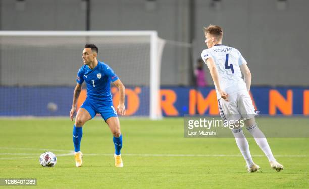 Eran Zahavi of Israel challenges Scott McTominay of Scotland during the UEFA Nations League group stage match between Israel and Scotland at Netanya...