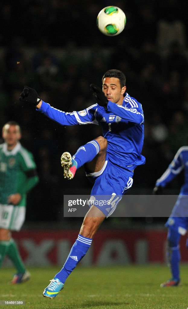 Eran Zahavi of Israel clears the ball during the FIFA 2014 World Cup qualifying football match between Northern Ireland and Israel at Windsor Park in Belfast, Northern Ireland on March 26, 2013. Israel won the game 2-0. AFP PHOTO/MICHAEL COOPER