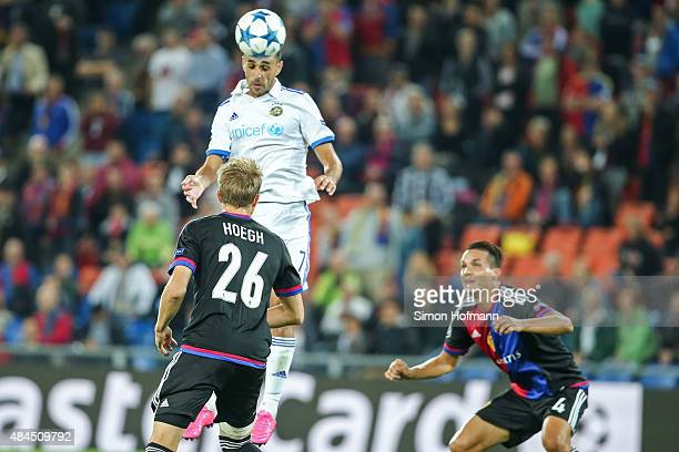 Eran Zahavi of Tel Aviv scores his team's second goal against Daniel Hoegh of Basel during the UEFA Champions League qualifying round play off first...