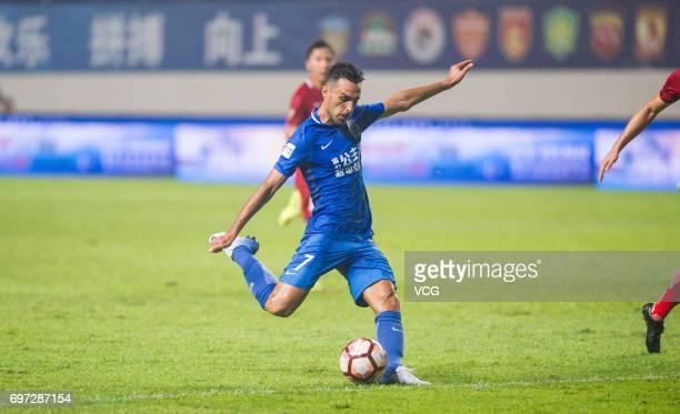 Eran Zehavi of Guangzhou Fuli kicks the ball during the 13th round match of 2017 Chinese Football Association Super League between Guangzhou Fuli and...