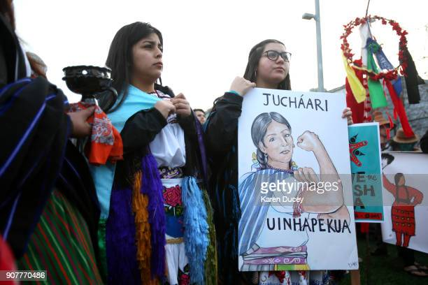Erandi Flores and Nadia Bucio, both from Mexico and from a group raising awareness for missing and murdered Indigenous women, join thousands at a...