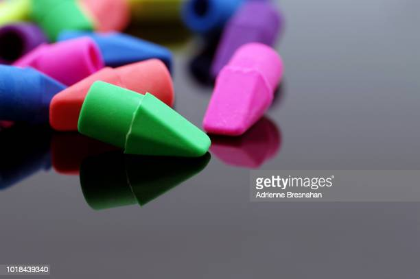 Erasers on Black Reflective Surface
