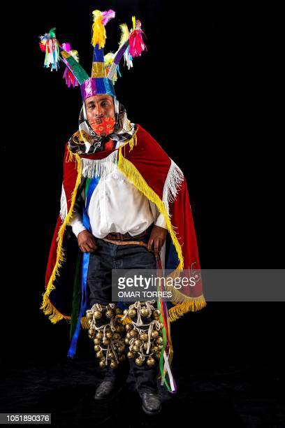 Erasmo Ortiz poses for a photograph with his traditional costume during the presentation of the Huey Atlixcayotl Festival on September 29 2018 in...