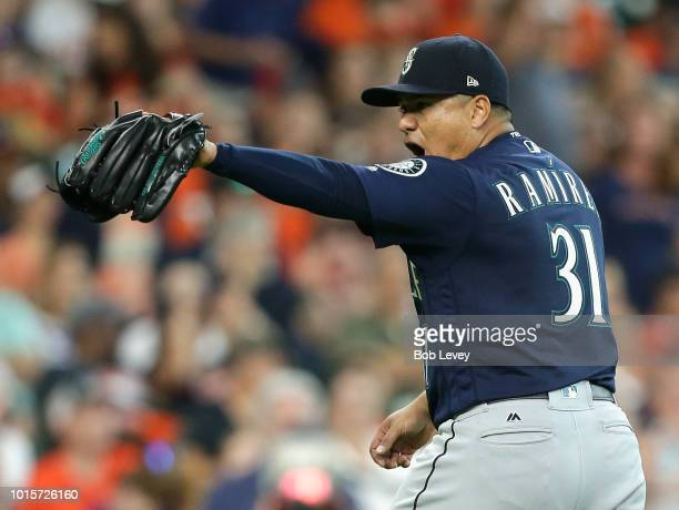 Erasmo Ramirez of the Seattle Mariners points to his catcher after getting out of a bases loaded situation in the fifth inning against the Houston...