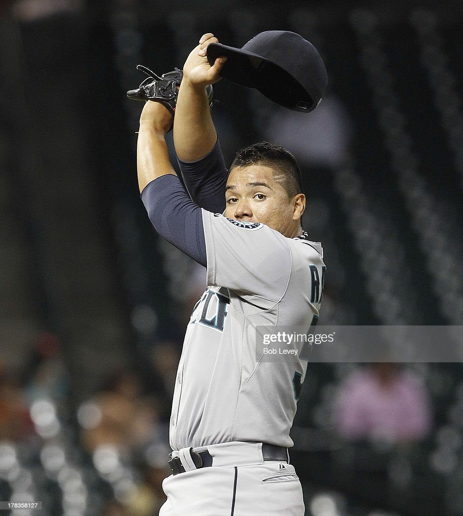 Erasmo Ramirez #50 of the Seattle Mariners wipes his brow in the fifth inning against the Houston Astros at Minute Maid Park on August 29, 2013 in Houston, Texas.