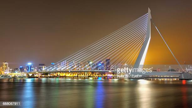 Erasmus Bridge Over River By Illuminated City At Night
