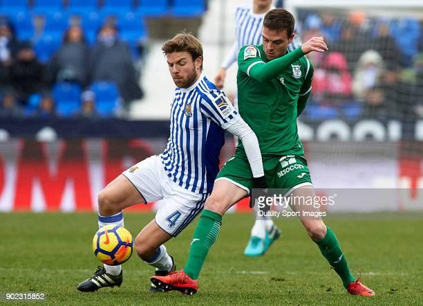 Eraso of Leganes competes for the ball with Asier Illarramendi of Real Sociedad during the La Liga match between Leganes and Real Sociedad at Estadio...