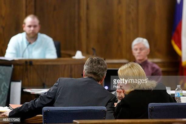 Erath County District Attorney Alan Nash and his assistant Jane Starnes confer while questioning former Rough Creek Lodge employee Justin Nabours...