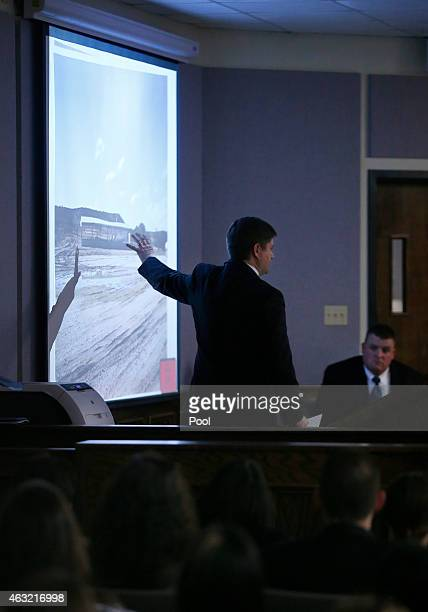 Erath County District Attorney Alan Nash displays photos of the Rough Creek Lodge and Resort where the deaths occurred during the capital murder...