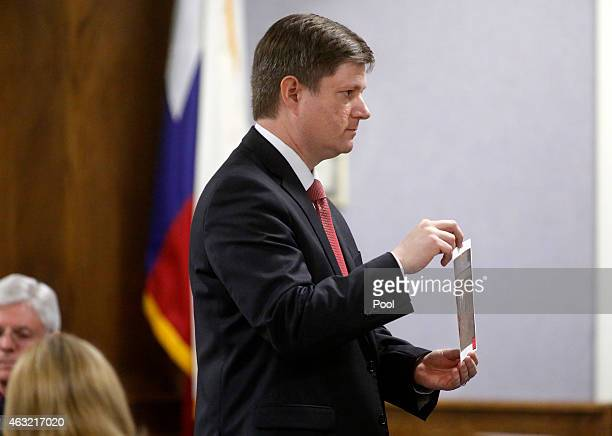Erath County District Attorney Alan Nash shows crime scene photos to the jury during the capital murder trial of former Marine Cpl. Eddie Ray Routh...