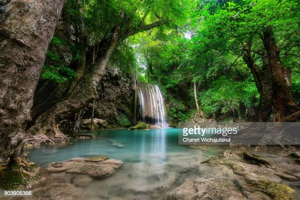 erawan waterfall is a beautiful waterfall in spring forest in kanchanaburi province, thailand. - カンチャナブリ県 ストックフォトと画像