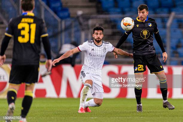 Eray Comert of Basel battles for the ball with Andrija Pavlovic of Apoel during the UEFA Europa League round of 32 second leg match between FC Basel...