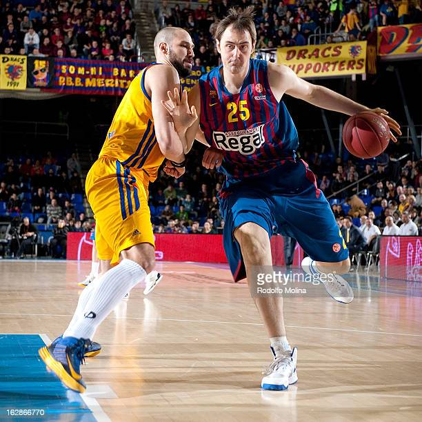 Erazem Lorbek #25 of FC Barcelona Regal competes with James Augustine #5 of BC Khimki Moscow Region during the 20122013 Turkish Airlines Euroleague...