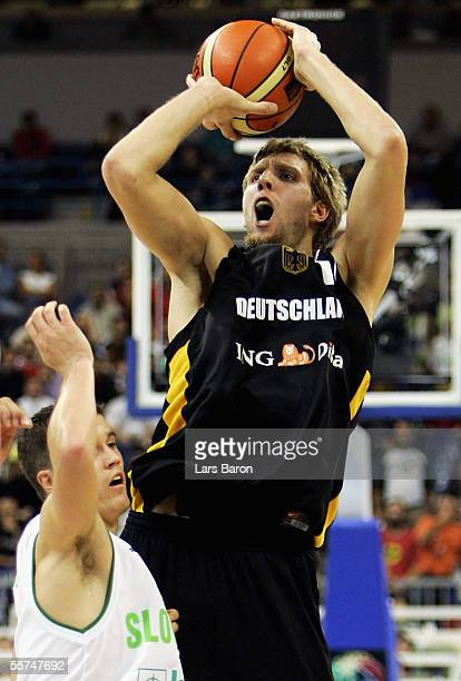Erazern Lorbek from Slovenia guards Dirk Nowitzki from Germany during the FIBA EuroBasket 2005 quarter final match between Slovenia and Germany on...
