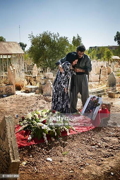 Mohamed Hosseini and his wife are grieving on their daughter's grave Nigar was a Peshmerga fighting against ISIS She was killed 3 days ago on the 6th...