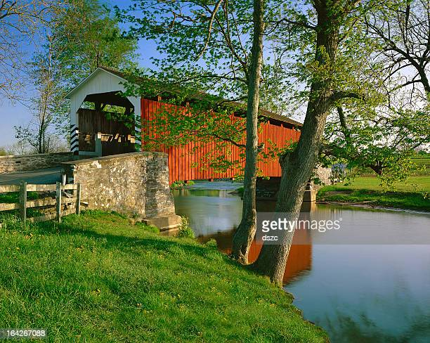 erb's covered bridge in lancaster county, pennsylvania - covered bridge stock photos and pictures
