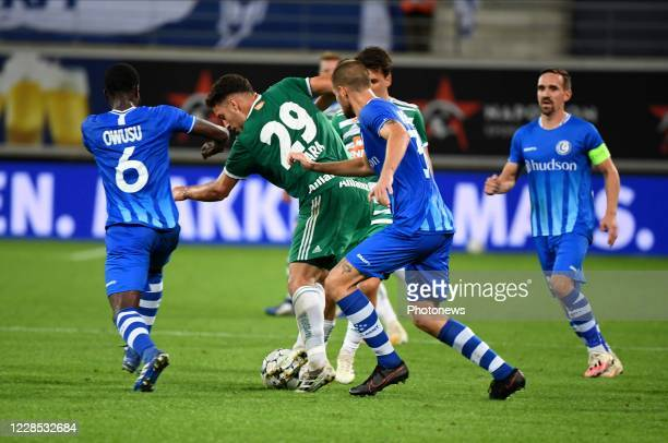 Ercan Kara midfielder of SK Rapid Wien and Dino Arslanagic defender of KAA Gent during the UEFA Champions League third qualifying round match between...