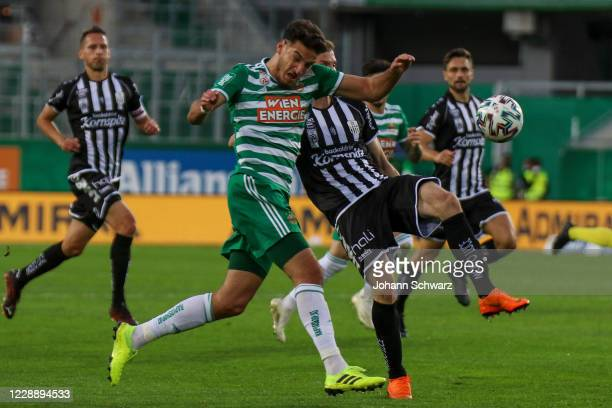 Ercan Kara of Rapid and Petar Filipovic of LASK during the tipico Bundesliga match between SK Rapid Wien and LASK at Allianz Stadion on October 4...