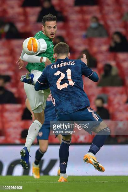Ercan Kara of Rapid Vienna and Calum Chambers of Arsenal battle for the ball during the UEFA Europa League Group B stage match between Arsenal FC and...
