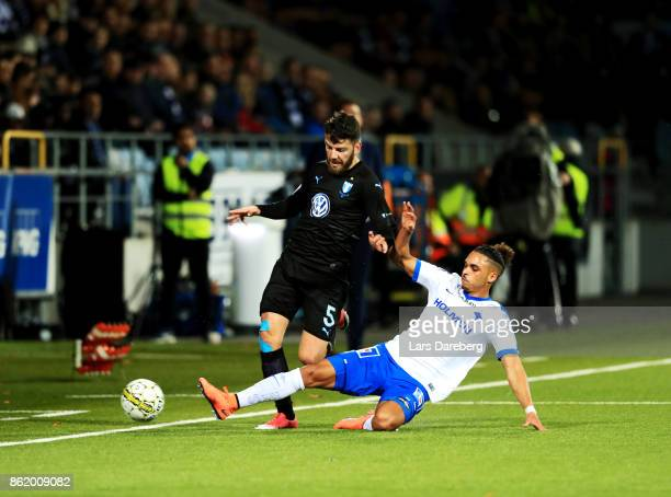 Erdal Rakip of Malmo FF and Alexander Jakobsen of IFK Norrkoping competes for the ball during the Allsvenskan match between IFK Norrkoping and Malmo...