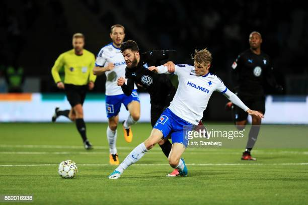 Erdal Rakip of Malmo FF and Eric Smith of IFK Norrkoping competes for the ball during the Allsvenskan match between IFK Norrkoping and Malmo FF at...