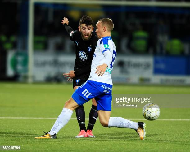 Erdal Rakip of Malmo FF and Gudmundur Thórarinsson of IFK Norrkoping competes for the ball during the Allsvenskan match between IFK Norrkoping and...