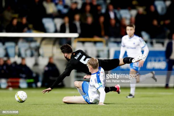 Erdal Rakip of Malmo FF is fouled by Eric Smith of IFK Norrkoping during the Allsvenskan match between IFK Norrkoping and Malmo FF at Ostgotaporten...