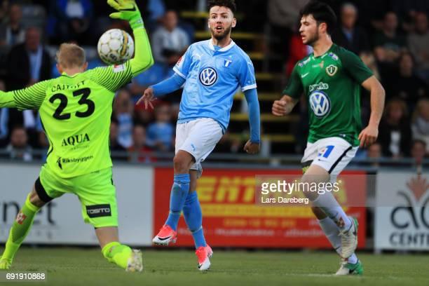 Erdal Rakip of Malmo FF scores the 12 goal behind Anton Cajtoft of Jonkopings Sodra during the Allsvenskan match between Jonkopings Sodra IF and...