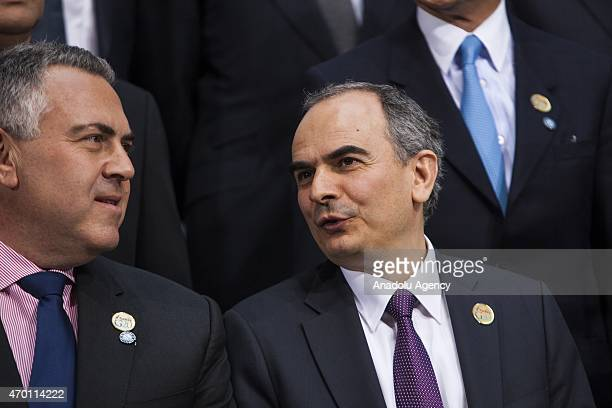 Erdem Basci Governor of the Central Bank of the Republic of Turkey talks with Joseph Hockey Treasurer of Australia during the G20 Family Photo at the...