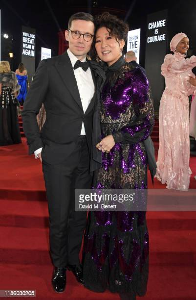Erdem Moralioglu and Sandra Oh arrive at The Fashion Awards 2019 held at Royal Albert Hall on December 2, 2019 in London, England.