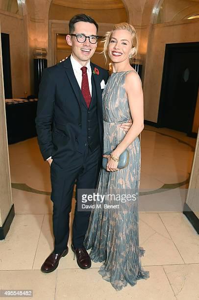 Erdem Moralioglu and Sienna Miller attend the Harper's Bazaar Women of the Year Awards 2015 at Claridges Hotel on November 3 2015 in London England